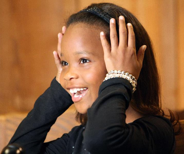 Child actress, Quvenzhane Wallis, who had her debut in the recent film 'Beasts of the Southern Wild,' speaks during an interview with the Associated Press in Houma, La., Sunday, Nov. 11, 2012. Quvenzhane, who doesn't watch much television aside from an occasional Disney Channel program, said she didn't know who Susan Sarandon was when the actress presented her with the New Hollywood award in Beverly Hills last month. Nor did she know Ben Affleck and Kerry Washington when the actors shook her hand and congratulated her during the Hollywood Awards ceremony. (AP Photo/Chris Heller)