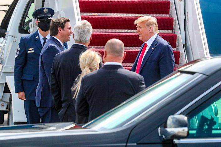 President Donald Trump arrives at Southwest Florida International Airport and deplaned at PrivateSky. Governor Ron DeSantis and Fort Myers Mayor Randy Henderson were among the small group welcoming the President.