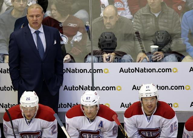 Montreal Canadiens head coch Michel Therrien, back, looks on against the Colorado Avalanche in the second period of an NHL hockey game in Denver on Monday, Dec. 1, 2014. (AP Photo/David Zalubowski)