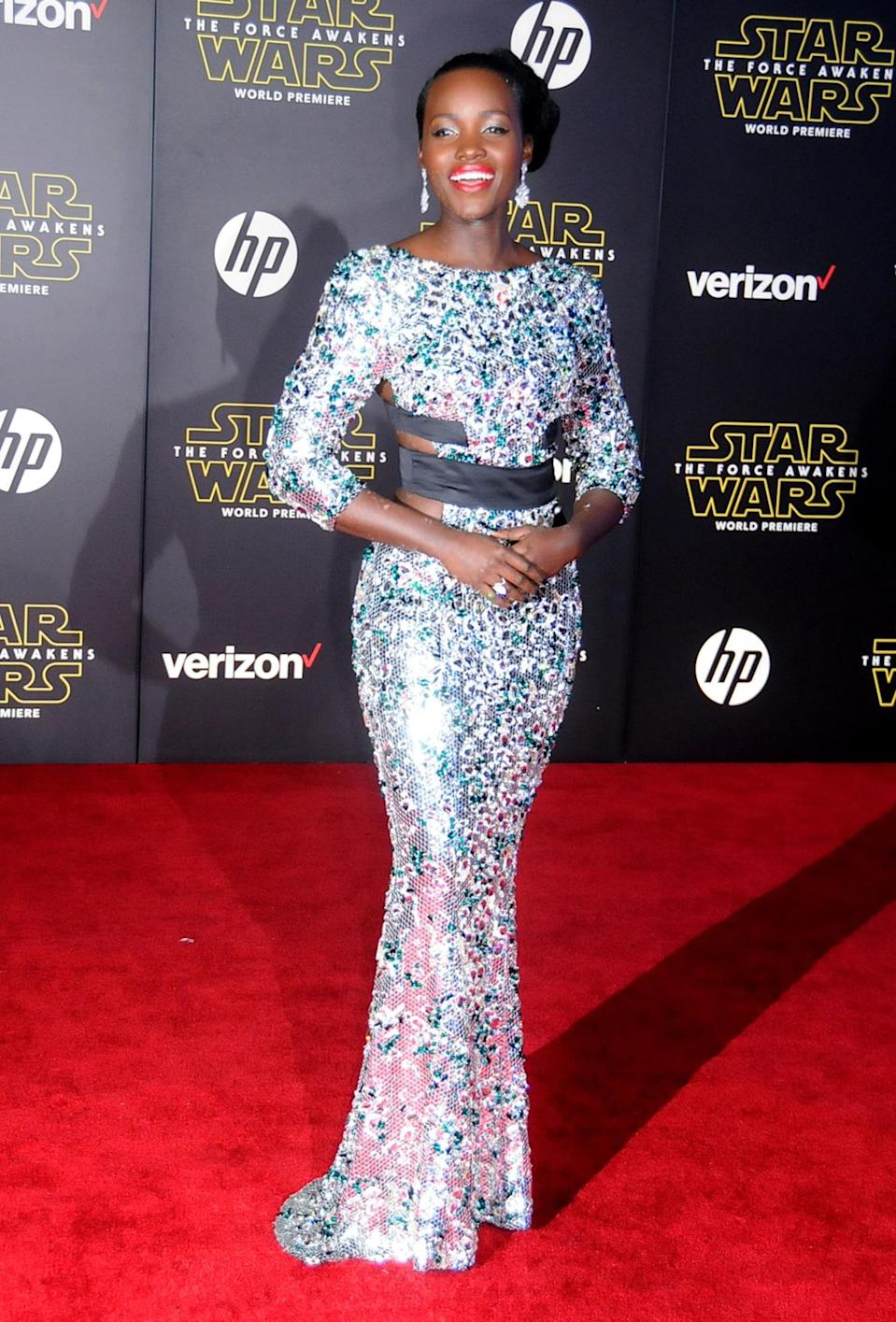 <p>Nyong'o continued to shine, wearing a glittering Alexandre Vauthier gown to the LA premiere of her new film, <i>Star Wars: The Force Awakens</i>. Black straps around the middle cut-outs kept the look from feeling too sweet, while her bright lip and statement earrings turned the whole thing festive.</p><p><i>Photo: Getty Images</i></p>