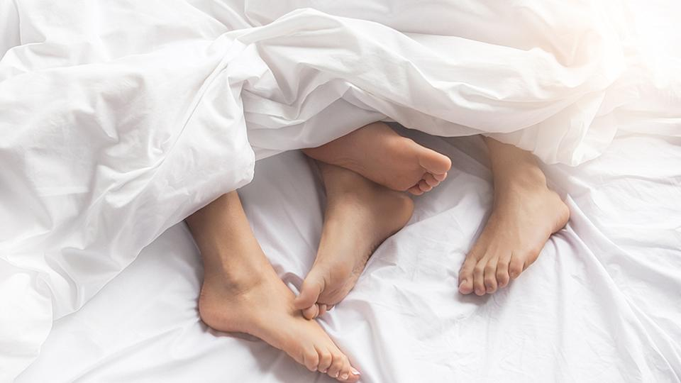 Couple under the sheets