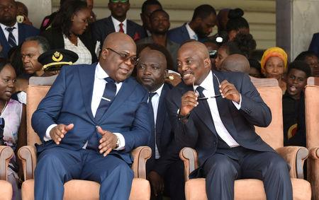 FILE PHOTO: Democratic Republic of Congo's outgoing President Joseph Kabila (R) sits next to his successor Felix Tshisekedi at the latter's inauguration ceremony in Kinshasa, Democratic Republic of Congo January 24, 2019. REUTERS/ Olivia Acland/File Photo