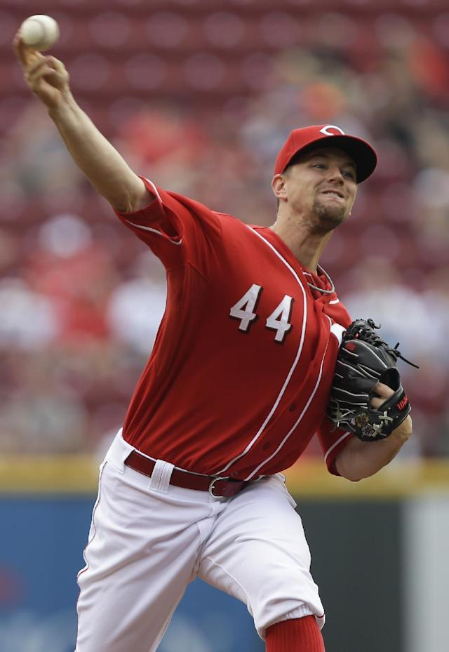 Cincinnati Reds starting pitcher Mike Leake throws against the Chicago Cubs in the first inning of a baseball game, Wednesday, Sept. 11, 2013, in Cincinnati. (AP Photo/Al Behrman)
