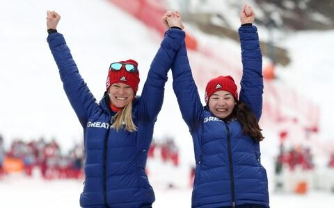 Great Britain's Menna Fitzpatrick (right) and her guide Jennifer Kehoe (left) celebrate gold at the Winter Paralympics - Credit: PA