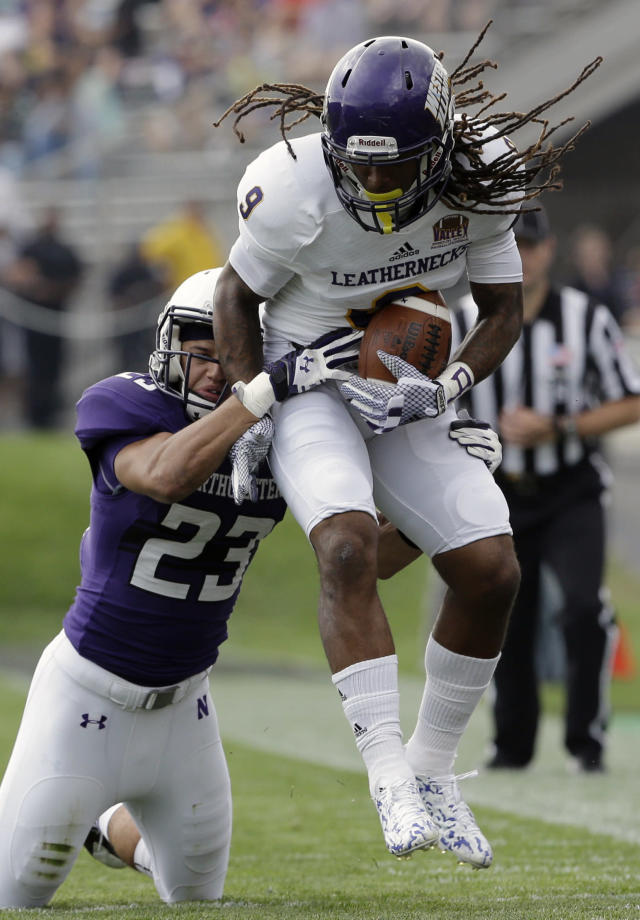 Northwestern cornerback Nick VanHoose (23), left, tackles Western Illinois wide receiver Quadarias Mireles (9) during the first half of an NCAA college football game in Evanston, Ill., Saturday, Sept. 20, 2014. (AP Photo/Nam Y. Huh)