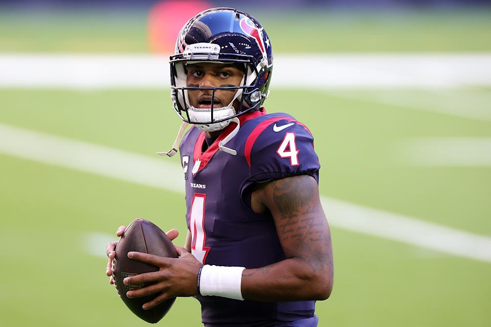 HOUSTON, TEXAS - JANUARY 03: Deshaun Watson #4 of the Houston Texans participates in warmups prior to a game against the Tennessee Titans at NRG Stadium on January 03, 2021 in Houston, Texas. (Photo by Carmen Mandato/Getty Images)