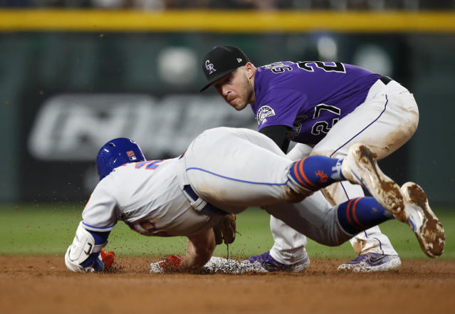 Colorado Rockies shortstop Trevor Story, back, tags out New York Mets' Pete Alonso as he slides into second base while trying to stretch a single into a double during the eighth inning of a baseball game Tuesday, Sept. 17, 2019, in Denver. (AP Photo/David Zalubowski)