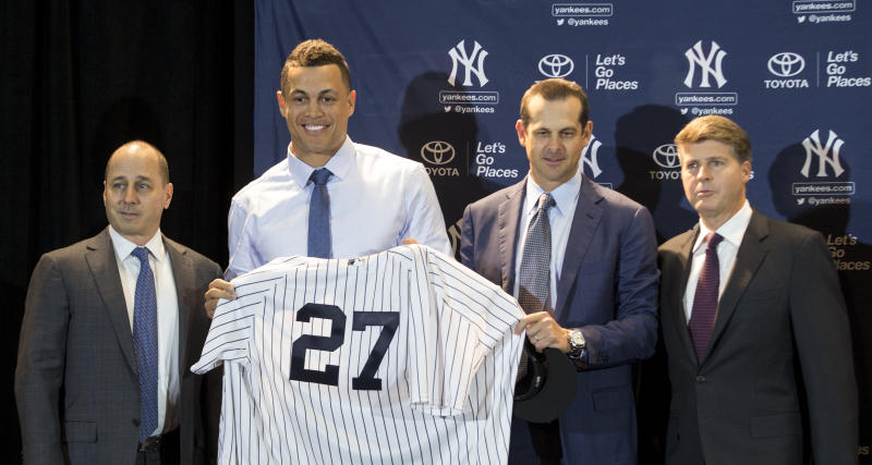 From left to right, Brian Cashman, Giancarlo Stanton, Aaron Boone, and Hal Steinbrenner will be expected to compete for a World Series. (AP)