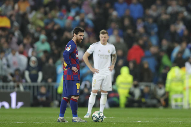 The La Liga title race between Real Madrid and Barcelona will be put on hold as the coronavirus spreads. (AP Photo/Manu Fernandez)