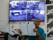 Palestinian Zuheir Rajabi has 10 surveillance cameras set up around his home, each displaying live footage