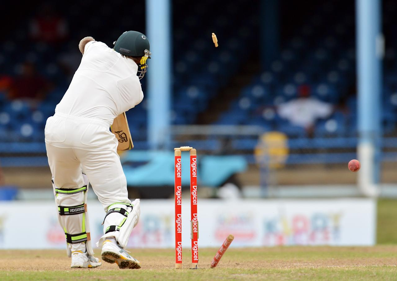 Australian batsman Ben Hilfenhaus is bowled out by West Indies Kemar Roach during the final day of the second-of-three Test matches between Australia and West Indies April19, 2012 at Queen's Park Oval in Port of Spain, Trinidad.