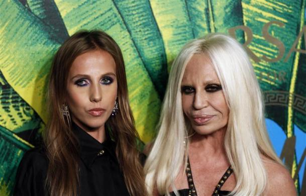 Designer Donatella Versace arrives with her daughter Allegra at a party to celebrate the upcoming launch of the Versace for H&M collection in New York, November 8, 2011.