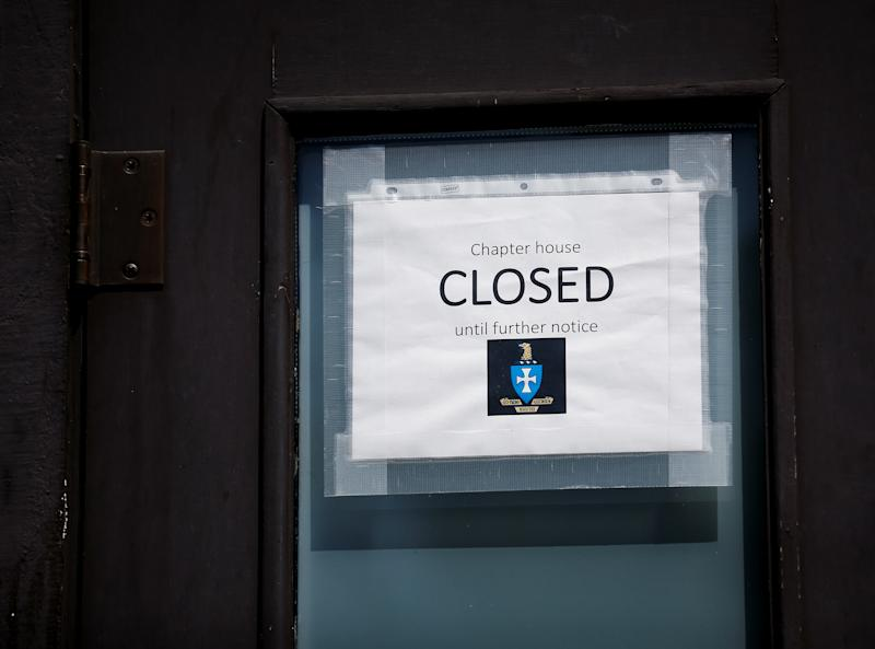 A closed sign is taped to the door of a fraternity house in the Greek Row area at the University of Washington in Seattle, Washington, U.S. August 5, 2020. Picture taken August 5, 2020. REUTERS/Lindsey Wasson