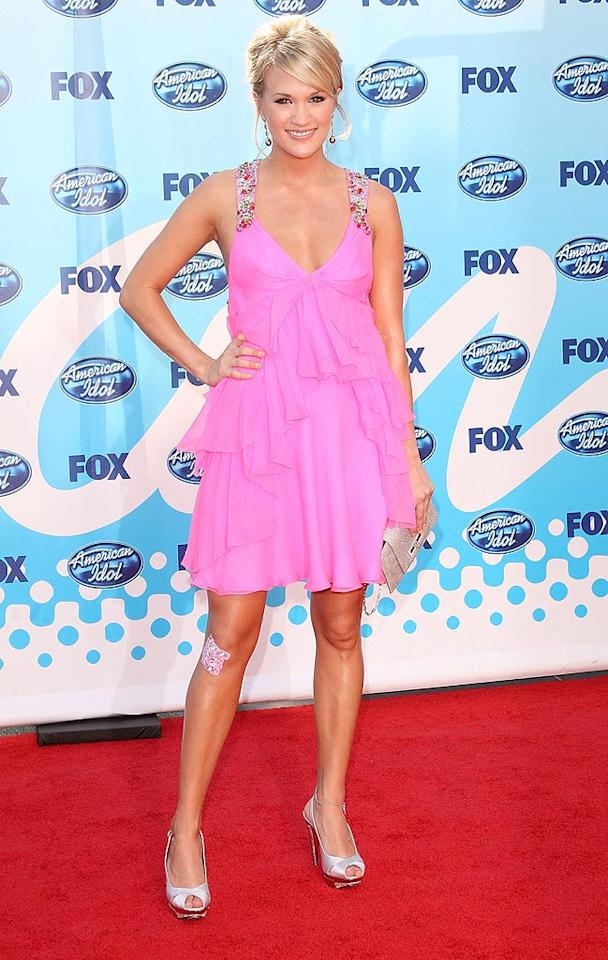 """Carrie Underwood (seen here at Wednesday's """"American Idol"""" finale) explained why she hobbled off the stage following her performance on Tuesday's show. The season four winner fell while jogging last weekend (hence the Band-aids on her leg). Jason Merritt/<a href=""""http://www.gettyimages.com/"""" target=""""new"""">GettyImages.com</a> - May 20, 2009"""