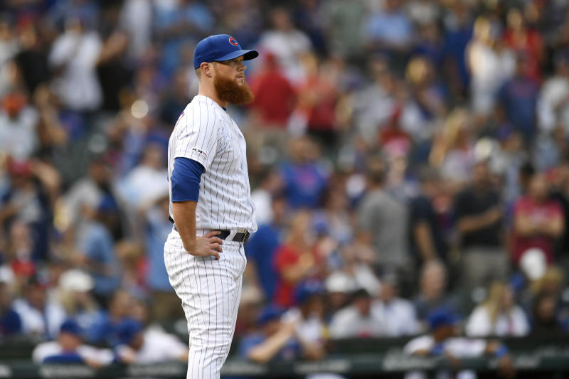Chicago Cubs closer Craig Kimbrell reacts after giving up a solo home run to St. Louis Cardinals' Yadier Molina during the ninth inning of baseball game Saturday, Sept. 21, 2019, in Chicago. (AP Photo/Paul Beaty)
