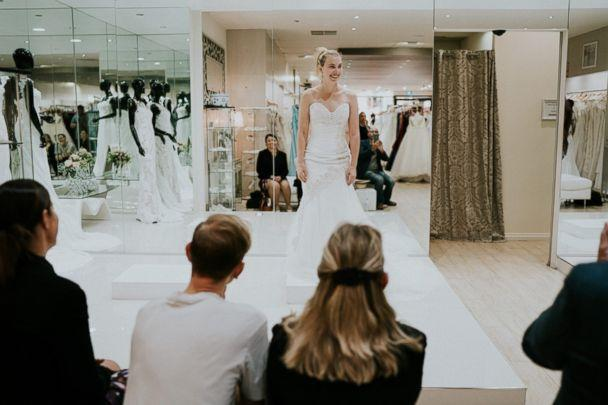 PHOTO: Blind bride Stephanie Agnew tries on wedding dresses at a bridal shop in South Melbourne, Victoria, Australia. (James Day - Wedding Photographer)