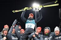 <p>Germany's Arnd Peiffer is carried by team members as they celebrate his gold win during the victory ceremony following the men's 10km sprint biathlon event during the Pyeongchang 2018 Winter Olympic Games on February 11, 2018, in Pyeongchang. / AFP PHOTO / FRANCK FIFE </p>