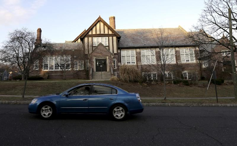 In this Dec. 27, 2013, photo, a car drives past Forest Avenue Elementary School in Glen Ridge, N.J. A presidential commission appointed by President Barack Obama is grappling with concerns that some schools no longer want to serve as polling places amid security concerns since the shooting in Newtown, Conn. Among those schools that have closed to balloting is Linden Avenue Elementary School. (AP Photo/Julio Cortez)