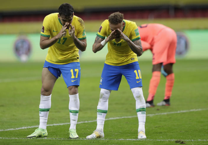 Brazil's Neymar, right, celebrates with Brazil's Lucas Paqueta after scoring his side's second goal on a penalty kick against Ecuador during a qualifying soccer match for the FIFA World Cup Qatar 2022 at Beira-Rio stadium in Porto Alegre, Brazil, Friday, June 4, 2021. (AP Photo/Andre Penner)