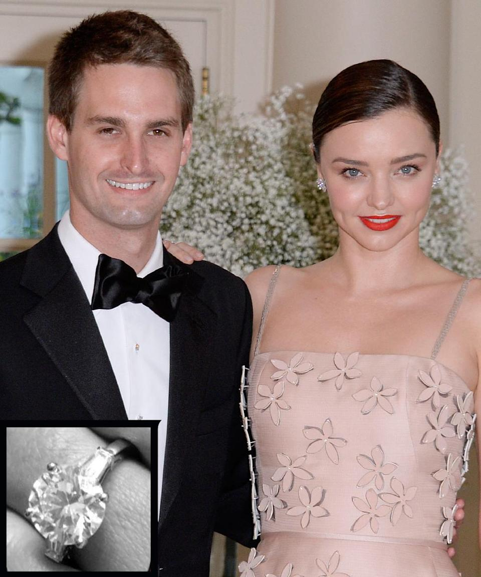 """<p>After a year of dating, Kerr and Spiegel got engaged in July 2016. The model confirmed the news <a rel=""""nofollow noopener"""" href=""""https://www.instagram.com/p/BIFrCEajY6y/"""" target=""""_blank"""" data-ylk=""""slk:on Instagram"""" class=""""link rapid-noclick-resp"""">on Instagram</a> with a black-and-white photo that shows a stunning round-cut rock on her left ring finger. The image also includes a Bitmoji that features two characters: a man crouching down on one knee as he presents a giant engagement ring to a woman who appears thrilled by the contents of the box. The words """"Marry Me!"""" appear at the bottom. """"I said yes!!!"""" Kerr wrote in the caption of her post.</p>"""