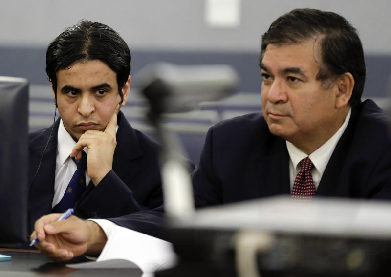 Mazen Alotaibi, left, listens with his attorney Don Chairez as the verdict is read, Wednesday, Oct. 23, 2013, at Clark County District Court in Las Vegas. The jury found the Saudi Arabian air force sergeant guilty of sexually assaulting a 13-year-old boy at a Las Vegas Strip hotel last New Year's Eve. He could face a sentence of 35 years to life in prison. (AP Photo/Julie Jacobson)