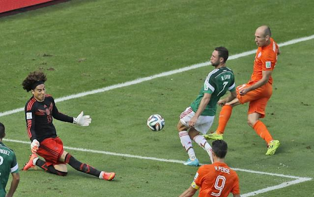 Mexico's goalkeeper Guillermo Ochoa, left, blocks a shot by Netherlands' Arjen Robben, right, during the World Cup round of 16 soccer match between the Netherlands and Mexico at the Arena Castelao in Fortaleza, Brazil, Sunday, June 29, 2014. (AP Photo/Themba Hadebe)