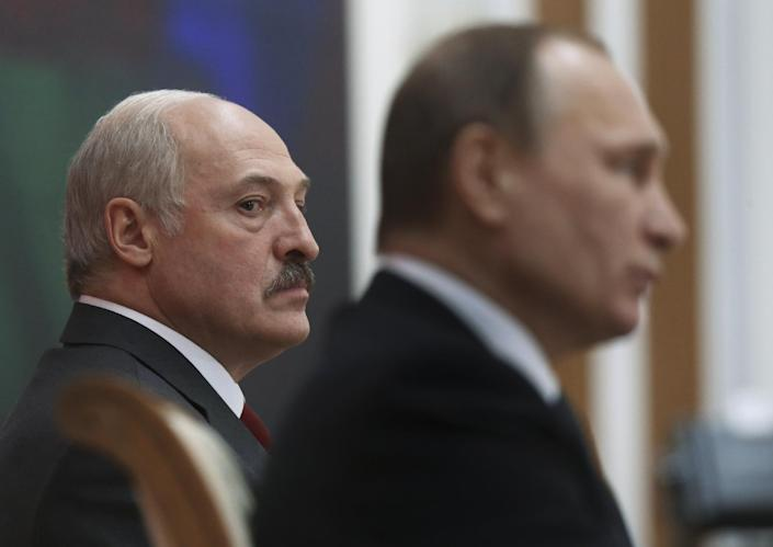 FILE - In this Thursday, Feb. 25, 2016 file photo, Belarusian President Alexander Lukashenko, left, and Russian President Vladimir Putin attend the talks in Minsk, Belarus. In more than two decades in power, the autocratic leader of Belarus has cast his nation as Moscow's closest ally, securing tens of billions of dollars in Russian subsidies. Now, the Kremlin finally seems to have lost patience with its unruly ally. (Yekaterina Shtukina/Pool Photo via AP, File)