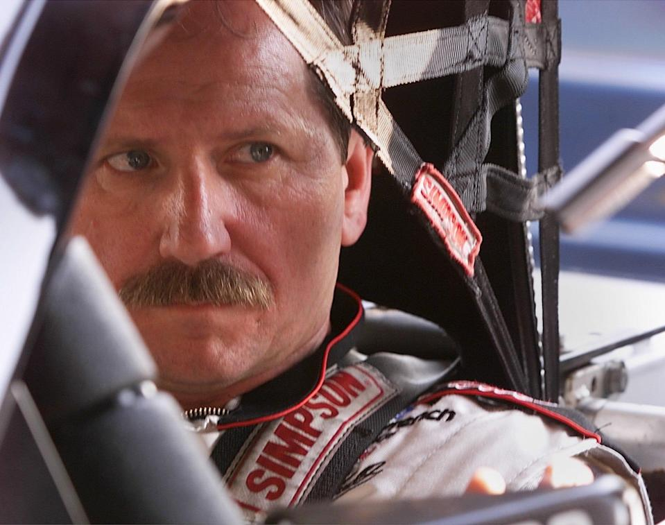 <em>Dale Earnhardt sits in his car during practice for the 1999 Daytona 500 (Kelly Jordan/USA TODAY Sports).</em>