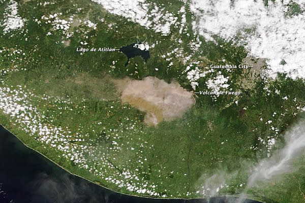 A picture taken by NASA's Terra satellite yesterday (Sept. 13) shows Guatemala's Fuego volcano spewing smoke and ash, which is being blown west from the volcano.