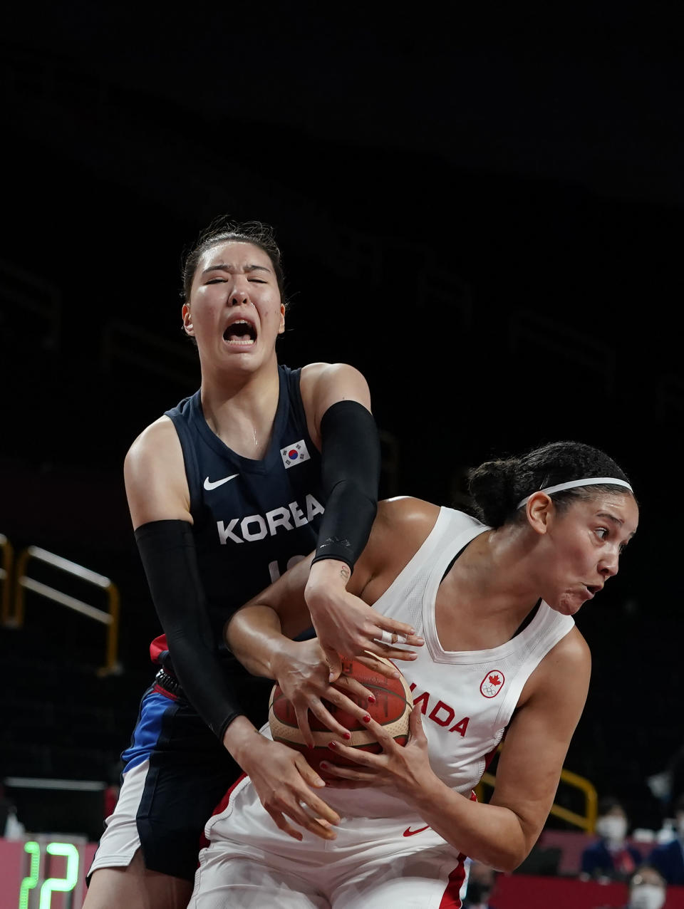 Canada's Natalie Achonwa (11), right, steals the ball from South Korea's Ji Su Park (19) during women's basketball preliminary round game at the 2020 Summer Olympics, Thursday, July 29, 2021, in Saitama, Japan. (AP Photo/Charlie Neibergall)
