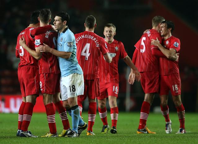 SOUTHAMPTON, ENGLAND - FEBRUARY 09: Gareth Barry of Manchester City congratulates Jay Rodriguez of Southampton as Southampton players celebrate victory at the final whistle during the Barclays Premier League match between Southampton and Manchester City at St Mary's Stadium on February 9, 2013 in Southampton, England. (Photo by Scott Heavey/Getty Images)