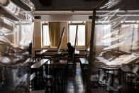 An ultra-Orthodox Jewish man studies in a Yeshiva, or Jewish seminary, equipped with partitions to protect against the spread of the coronavirus disease (COVID-19), in the Mea Shearim neighbourhood of Jerusalem