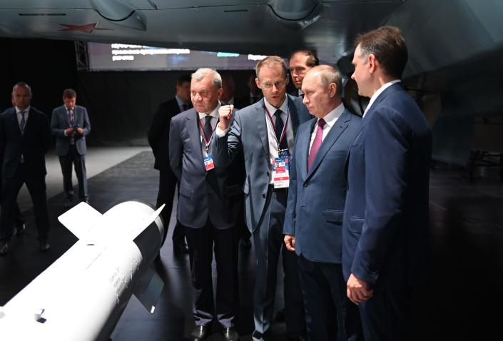 Russian President Vladimir Putin, second right, inspects new models of weapons at the MAKS-2021 International Aviation and Space Salon outside Zhukovsky, Russia, Tuesday July 20, 2021. Russia on Tuesday unveiled a prototype of its prospective new fighter jet at the Moscow air show. (Alexei Nikolsky, Sputnik, Kremlin Pool Photo via AP)
