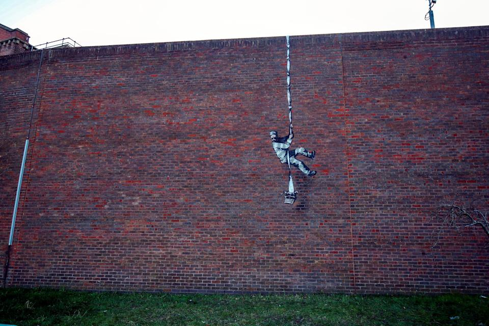 The artwork on the wall of the former prison (PA Wire)