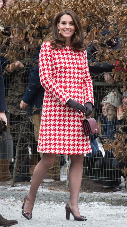 "<p>To meet crowds in Stockholm, the pregnant royal donned a houndstooth-emblazoned dress by Alexander McQueen and her go-to Chanel Nouvelle Flap Bag (approx £3,500). <br />She accessorised the look with a pair of gloves by <a rel=""nofollow"" href=""https://www.corneliajames.com//products/imogen-merino-wool-gloves?variant=1777663427"">Cornelia James</a> (£70), £107 <a rel=""nofollow"" href=""https://in2designing.com/collections/earring/products/baroque-ear-go-wh"">baroque earrings</a> and Tod's burgundy-hued block heels (£216). <em>[Photo: Getty]</em> </p>"