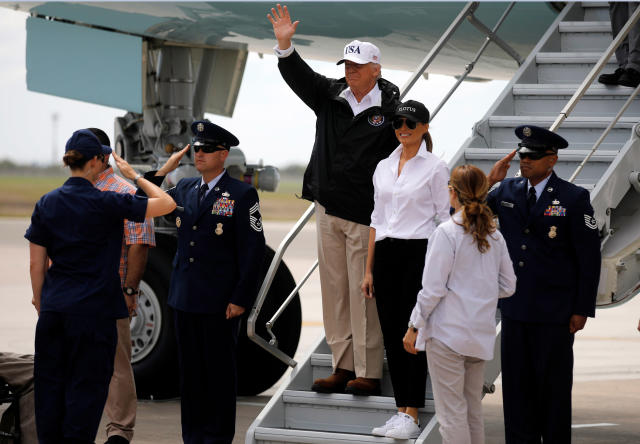 <p>President Donald Trump (C) waves next to first lady Melania Trump upon arrival prior to receiving a briefing on Tropical Storm Harvey relief efforts in Corpus Christi, Texas, U.S., August 29, 2017. (Photo: Carlos Barria/Reuters) </p>