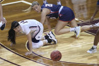 Gonzaga's Kaylynne Truong (14) loses the ball as Belmont's Conley Chinn (20) defends during the first half of a college basketball game in the first round of the women's NCAA tournament at the University Events Center in San Marcos, Texas, Monday, March 22, 2021. (AP Photo/Chuck Burton)