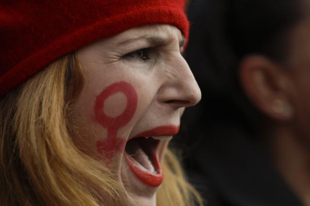 <p>A woman shouts slogans during a march as part of the International Day for the Elimination of Violence against Women, in Rome, Saturday, Nov. 25, 2017. (Photo: Gregorio Borgia/AP) </p>