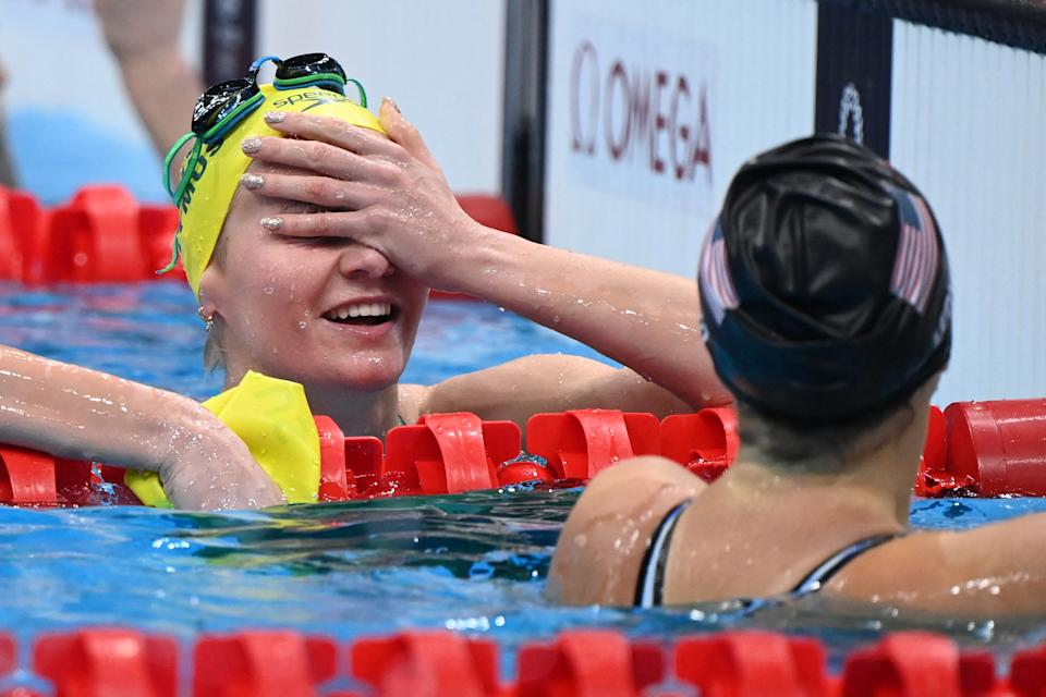 Pictured here, Ariarne Titmus looks relieved after beating Katie Ledecky for the 400m freestyle gold.