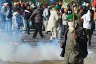 Police fire tear gas to disperse farmers at a roadblock
