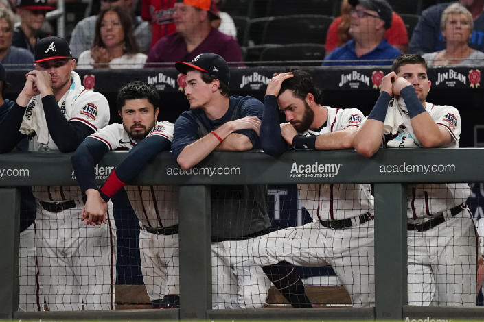 The Atlanta Braves watch from the dugout in the ninth inning of their 5-4 loss to Colorado Rockies in a baseball game Tuesday, Sept. 14, 2021, in Atlanta. (AP Photo/John Bazemore)