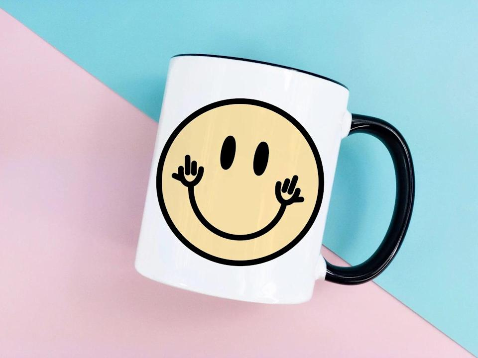 <p>This <span>Middle Finger Smiley Coffee Mug</span> ($15) is a mood. They'll love to drink their morning coffee in this fun yet expressive mug. </p>