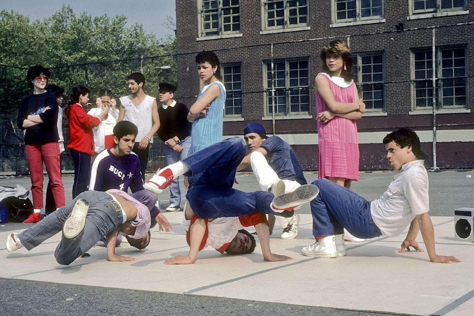 <p>Break-dancers work on their routine in the yard of a New York City junior high school. </p>