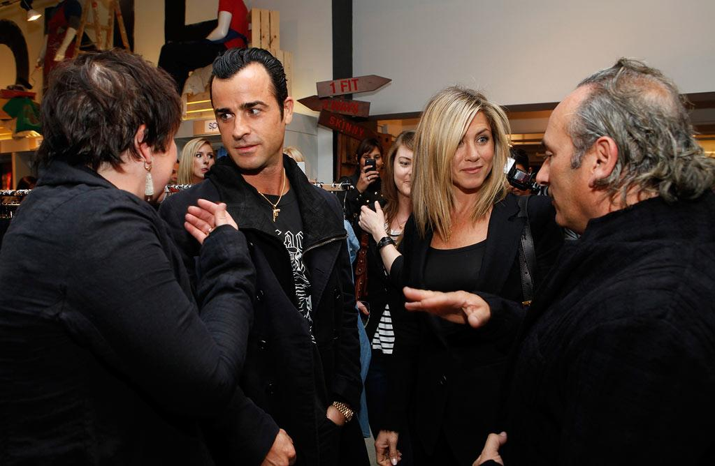 """Jennifer Aniston and her new love Justin Theroux hit up Bloomingdale's in NYC Thursday night for the launch of Hoyle Jackson denim. Aniston's stylists, twin sisters Clare and Nina Hallworth, happen to be the designers of the line. Amy Sussman/<a href=""""http://www.wireimage.com"""" target=""""new"""">WireImage.com</a> - September 15, 2011"""