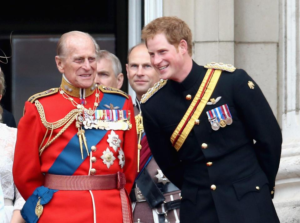 <p>The Duke of Edinburgh and Prince Harry share a joke during Trooping the Colour in 2014</p> (Getty)