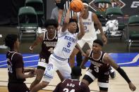 Memphis guard Boogie Ellis (5) makes a pass as Mississippi State forward Derek Fountain (20), Cameron Matthews (4), Abdul Ado, bottom front, and D.J. Stewart Jr. (3) defend in the first half of an NCAA college basketball championship game in the NIT, Sunday, March 28, 2021, in Frisco, Texas. (AP Photo/Tony Gutierrez)