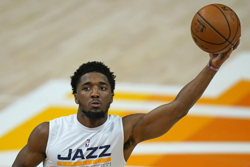 Utah Jazz guard Donovan Mitchell works on the court before the team's NBA basketball game against the Portland Trail Blazers on Wednesday, May 12, 2021, in Salt Lake City. Mitchell will miss the final three games of the regular season as he continues to receive treatment for the sprained ankle that has kept him out since April 16, the team said Tuesday. (AP Photo/Rick Bowmer)