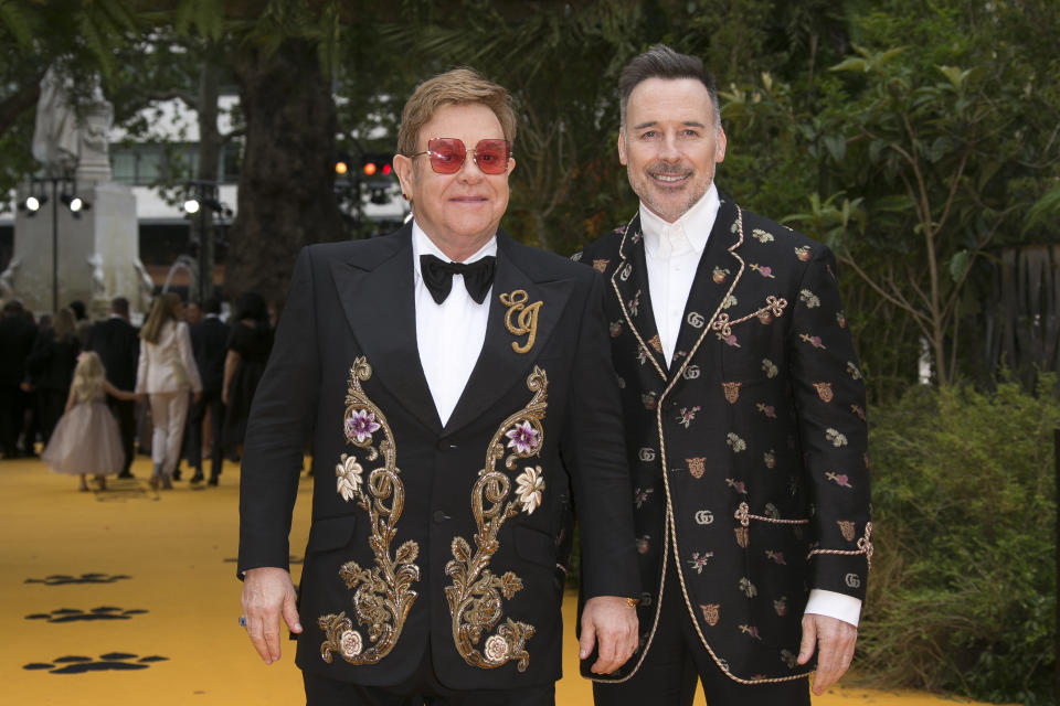 Sir Elton John and David Furnish pose for photographers upon arrival at the 'Lion King' European premiere in central London, Sunday, July 14, 2019. (Photo by Joel C Ryan/Invision/AP)