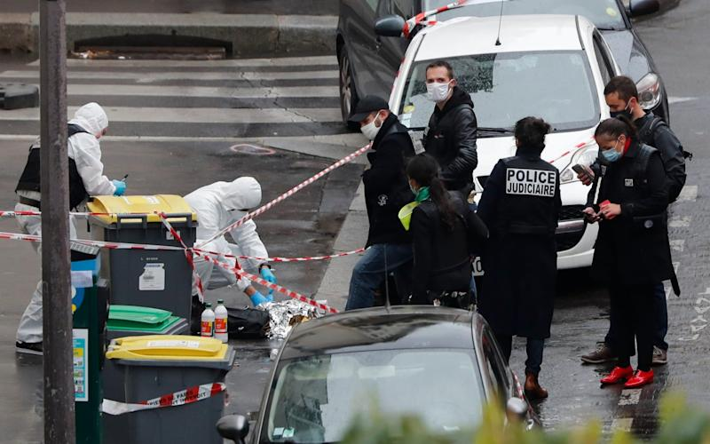 Police at the site of the September 2020 attack near the former offices of the satirical paper, Charlie Hebdo - AP