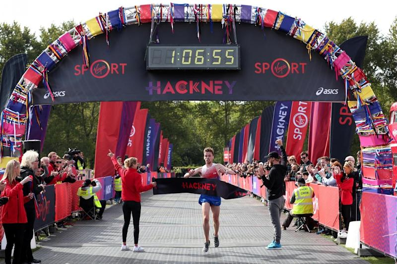 Finish: Runner Paul Whittaker crosses the line to win the half marathon (PA)